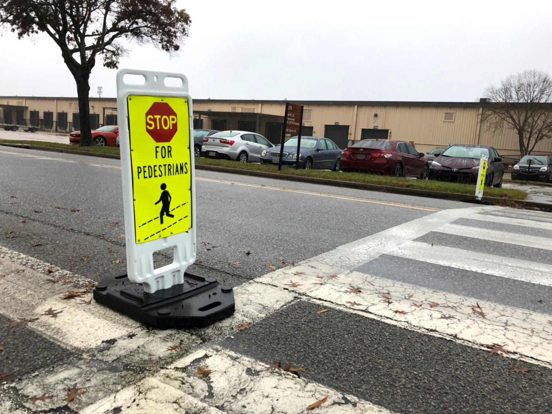 Pedestrian crosswalk and stop sign